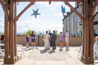 Wedding ceremony at The Omni Grove Park Inn in Asheville NC on the Vanderbilt Terrace