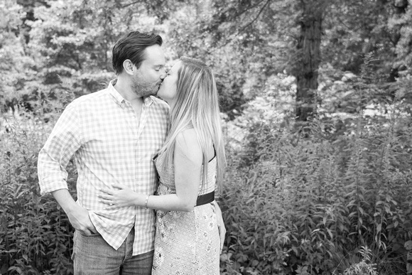 Couple kissing after marriage proposal at The NC Arboretum in Asheville