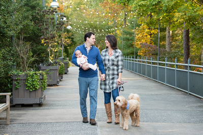 Family walking with dog during photos at The NC Arboretum