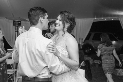 Bride and groom dancing at reception in black and white