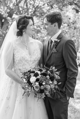 Bride and groom looking at each other in black and white