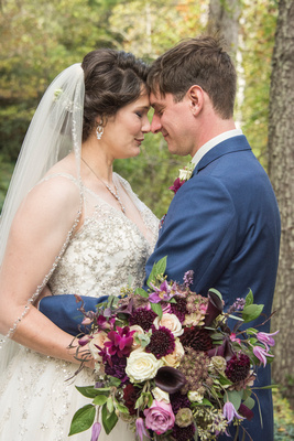 Bride and groom touching noses in Asheville
