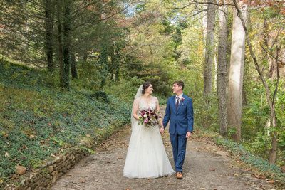 Bride and groom walking at talking at Bull Creek Ranch in Asheville