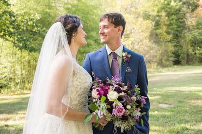 Groom smiling at bride in Asheville