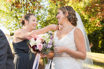 Bride and bridemaid at Reflections at the Pond in Asheville