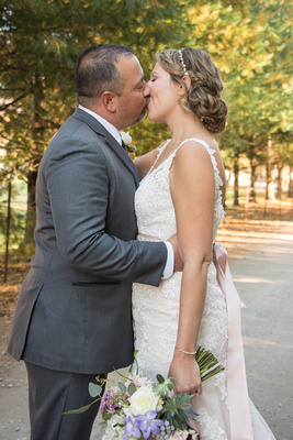 Bride and groom kissing at Reflections at the Pond in Asheville