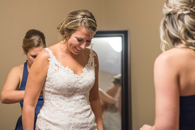Bride getting ready for her wedding at Reflections at the Pond in Asheville