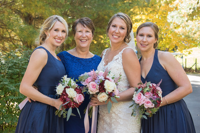Bride with Mom and sisters at Reflections at the Pond