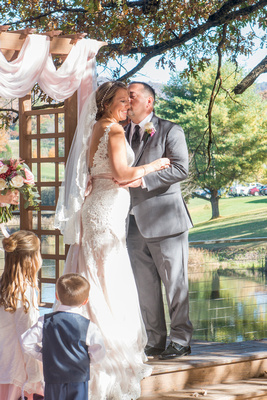 Wedding ceremony kiss at Reflections at the Pond in Asheville
