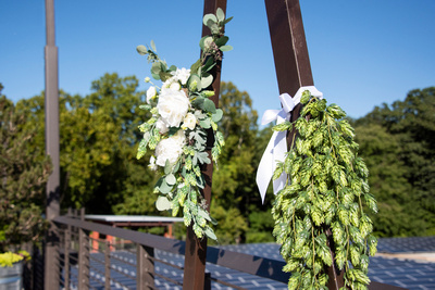 Hops and flowers wedding arch at Highland Brewing Wedding in Asheville