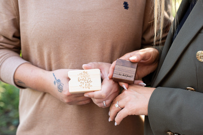 lgbtq couple showing ring boxes after engagement at Biltmore Estate in Asheville NC