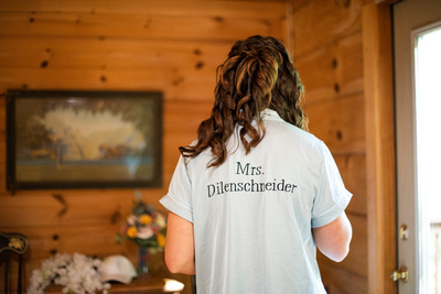 Bride getting ready in Honeymoon Cabin at Laughing Waters wedding venue near Asheville NC
