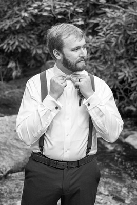Groom getting ready at Laughing Waters wedding venue near Asheville NC