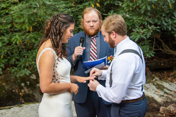 Ring ceremony during wedding at Laughing Waters wedding venue near Asheville NC
