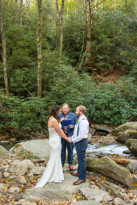 Wedding ceremony in creek at Laughing Waters wedding venue near Asheville NC
