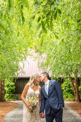 Bride and groom kissing at Hawkesdene