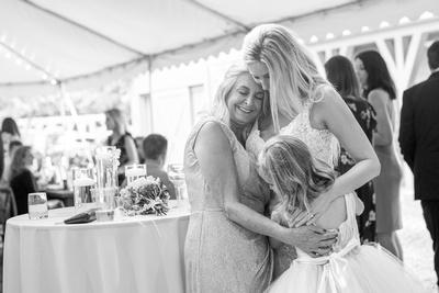 Bride mother and daughter hugging at Hawkesdene wedding