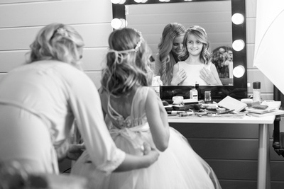 Flower girl and bride getting ready at Hawkesdene in Andrews
