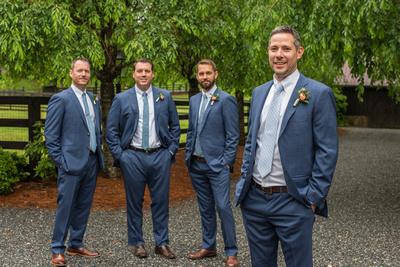 Groom and groomsmen in blue suits at Hawkesdene wedding