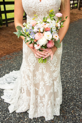 Spring bridal bouquet with wedding dress at Hawkesdene in Andrews