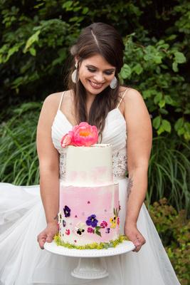Bride holding wedding cake at Haiku I Do in Asheville