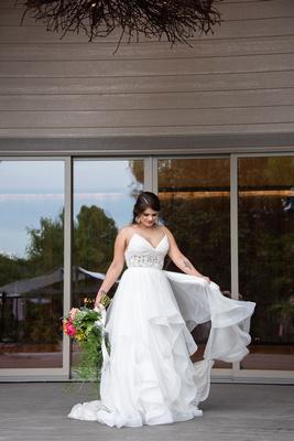 Bride showing off dress at Haiku I Do in Asheville