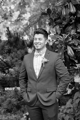 Groom laughing in black and white at Haiku I Do in Asheville