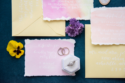 Invitations and rings by The Tristar Scribe at Haiku I Do wedding in Asheville