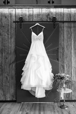 Maggi bridal gown hanging at Haiku I Do wedding in Asheville
