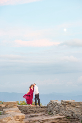 Craggy Pinnacle engagement photo with moon at sunset