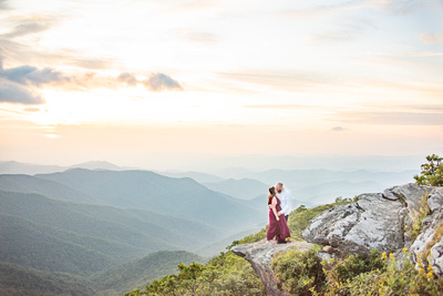 Mountain top engagement photography at sunset at Craggy Pinnacle near Asheville