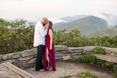 Sunset engagement photos in red dress at Craggy Pinnacle near Asheville