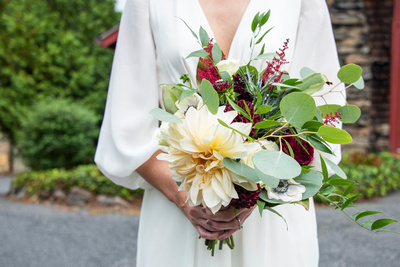 Bride holding bouquet at Homewood castle in Asheville
