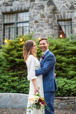 Groom laughing at camera at Homewood wedding in Asheville