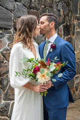Married couple kissing at Homewood wedding in Asheville