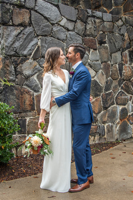 Wedding portrait of bride in classic white dress and groom in navy suit at Homewood in Asheville