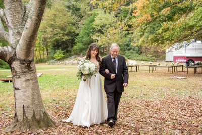 Bride and her father at wedding ceremony at Asheville Botanical Gardens