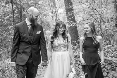 Married couple and daughter at Asheville Botanical Gardens