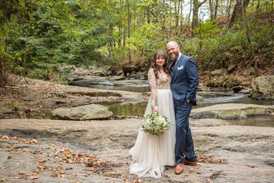 Wedding portrait in creek at Asheville Botanical Gardens