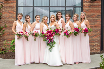 Fall wedding with pink dresses at The Foundry in Asheville