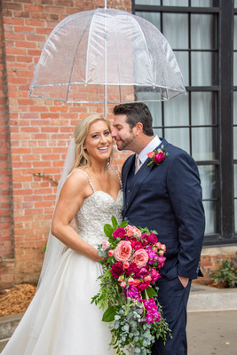 Wedding portrait with umbrella at The Foundry in Asheville