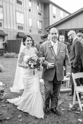 Bride and father walking down the aisle at The Lodge at Flat Rock wedding ceremony