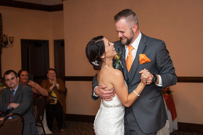 aBride and groom first dance photo in ballroom at The Lodge at Flat Rock