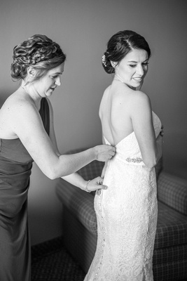 Bride and maid of honor getting ready at The Lodge at Flat Rock near Asheville
