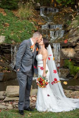 Fall wedding photo at waterfall at The Lodge at Flat Rock