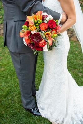 Lace wedding dress and gray suit at fall wedding at The Lodge at Flat Rock