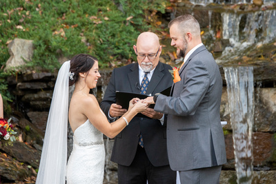 Ring ceremony during wedding at The Lodge at Flat Rock near Asheville