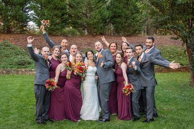 Wedding party celebrates at fall wedding at The Lodge at Flat Rock