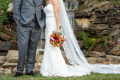 Wedding photo at waterfall near Hendersonville at The Lodge at Flat Rock