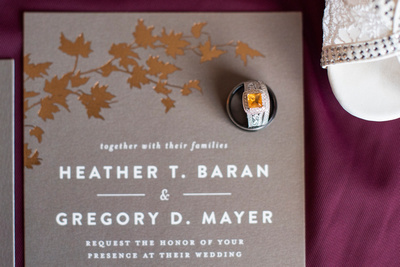Wedding rings and invitation at The Lodge at Flat Rock near Hendersonville